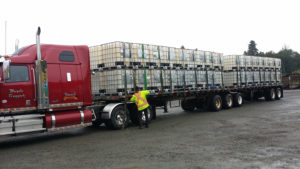 B Train trcuk full of bulk Grassoline Brand Liquid Fish Fertilizer